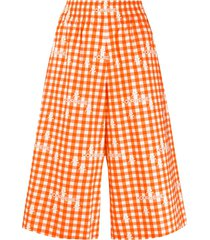 courrèges over-the-knee length check shorts - orange