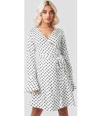 afj x na-kd dot print wrap mini dress - white