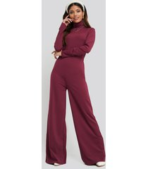 na-kd turtle neck long sleeve jersey jumpsuit - red