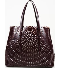 alaia laser cut leather tote bag