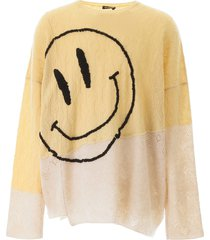 raf simons oversized sweater with smiley