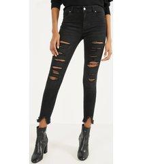 skinny fit jeans met lage taille en scheuren