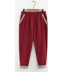 pantaloni vintage larghi con tasche patchwork