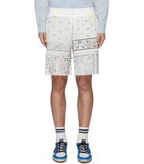 contrast leather patch topstitch fringe hem bandana print shorts