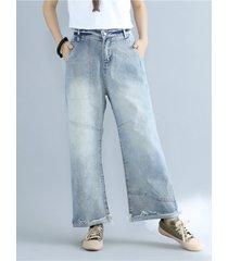 pantaloni vintage in denim blu chiaro con tasche