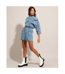 macaquinho jeans com recortes manga 3/4 gola alta azul médio