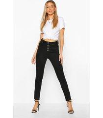 skinny jeans met knopen en hoge taille
