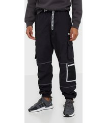 fila men uba wind pants byxor black