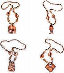 donna vintage collana lunga con perline di legno a manufatto con pendente a forma di pesce elefante