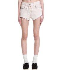 alanui shorts in beige cotton