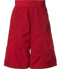 ami oversized track shorts - red