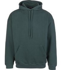 woman green oversize hoodie with back logo