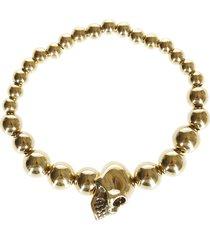 alexander mcqueen gold-tone brass skull bracelet