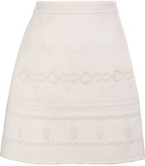 white mini skirt with embroidery