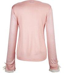 finstickad tröja med rosett på ärmarna dress in rosa