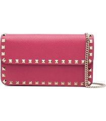 valentino garavani rockstud chain-strap clutch bag - pink