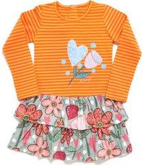 vestido naranja a croquer bosque