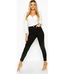skinny jeans met gerafelde zoom, zwart