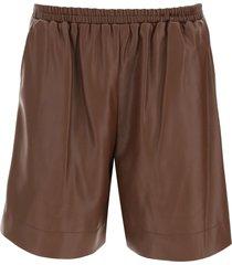 staud clark shorts in vegan leather