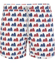 capri code white swimsuit with red and blue faraglioni pattern