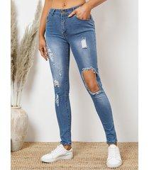 detalles rasgados al azar del bolsillo lateral recortado en azul jeans