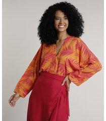 body feminino blusê estampado de folhagem manga longa decote v laranja