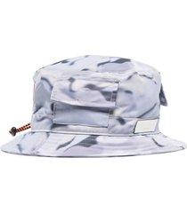 heron preston camouflage-pattern bucket hat - multicolour