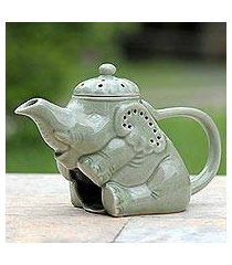 ceramic oil warmer, 'adorable elephant' (thailand)