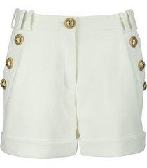 balmain low waist cotton shorts with golden buttons