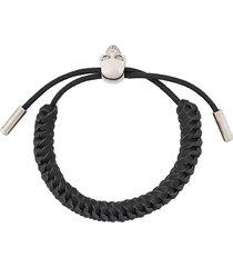 alexander mcqueen man black skull bracelet in woven leather with sliding closure