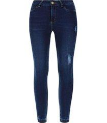 jean  mujer con desgaste en frente y botas color azul, talla 14