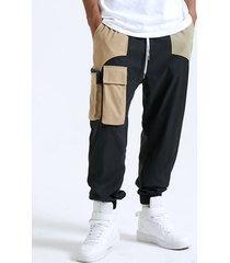 bolsillo con solapa de empalme en bloque de color informal para hombre carga pantalones