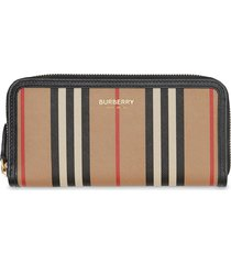 burberry icon stripe e-canvas and leather zip-around wallet - neutrals