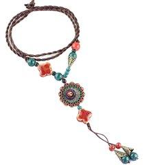 collana con pendente di cermica di fiore