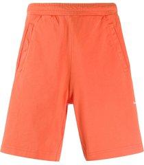 acne studios organic cotton track shorts - orange