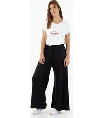 pantalón de mujer,  silueta paper bag de corte acampanado, color negro
