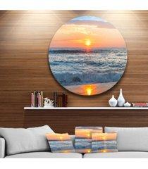 "designart 'beautiful sunrise over the horizon.' beach metal circle wall art - 23"" x 23"""