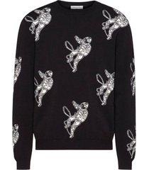 black and white astronaut sweater